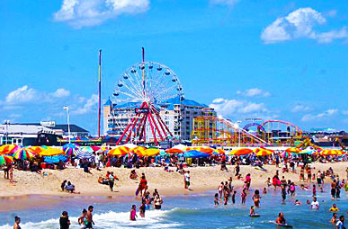 people on Ocean City, NJ beach with ferris wheel in background